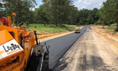 pavement machine laying fresh asphalt