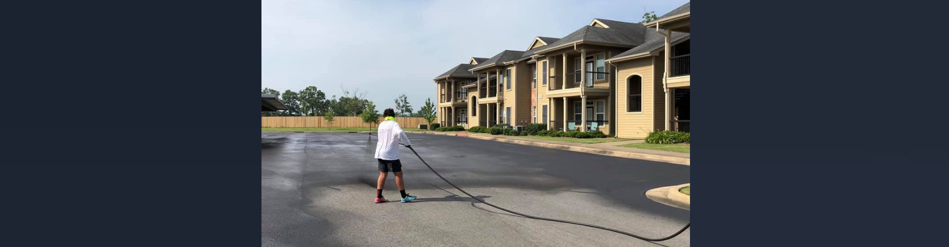 worker paving a residential street